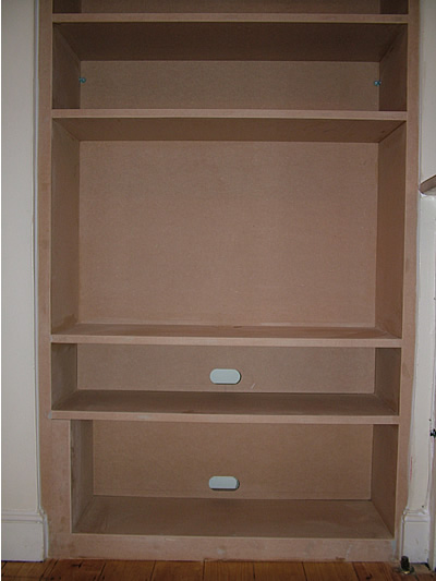 flat_panel_tv_display_and_fitted_alcove_bookcases_by