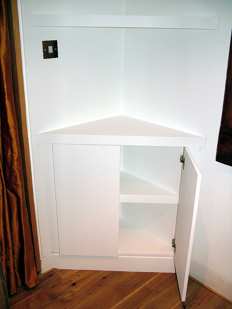Triangular Corner Cupboard With Floating Shelves By